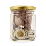 Egyptian Pounds, Coins in Jar, Isolated on White Background Stock Photo