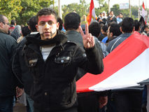 Egyptian protestor flash victory sign royalty free stock image