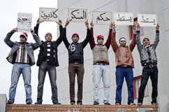 Egyptian protestors holding protest signs royalty free stock photo