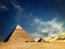 Egyptian pyramid. On a cloudy cky royalty free stock image