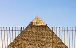 An Egyptian Pyramid behind a fence. Royalty Free Stock Photo