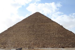 Egyptian pyramids. Egyptian giza pyramid over cloudy sky Stock Photos