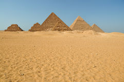 Egyptian pyramids in the desert Stock Images
