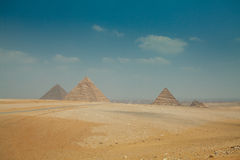 Egyptian pyramids in heat yellow sands Royalty Free Stock Image