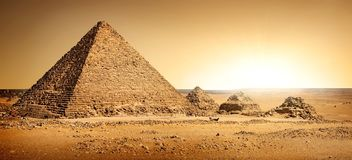 Egyptian pyramids in sand. Desert and clear sky stock images