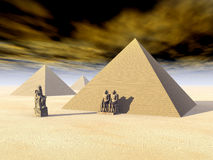 Egyptian Pyramids and Statues Royalty Free Stock Images