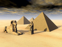 Egyptian Pyramids and Statues Stock Images