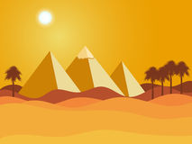 Egyptian pyramids. Sun over the pyramids. Desert. Royalty Free Stock Image