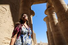 Egyptian woman at Ramesseum temple in Luxor - Egypt Stock Photos