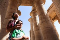 Mother with child at Ramesseum temple in Luxor - Egypt Stock Photo
