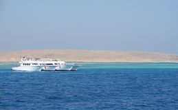 Egyptian Red Sea scenery. Sunny coastal scenery showing some boats on the Red Sea in Egypt Stock Photo