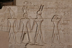 Egyptian Relief. Pharaoh Ramses II before gods Horus and Thoth, a relief in the Ramessum near Luxor (Thebes), Egypt stock photos