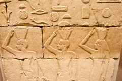 Egyptian relief with three offering people Royalty Free Stock Photos