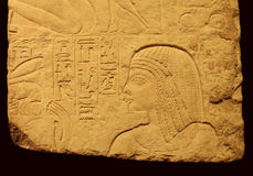 Egyptian relief with young woman Stock Photo