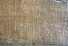 Egyptian reliefs. Egyptian hieroglyphs in relief on stone Royalty Free Stock Photo