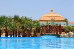 Egyptian resort swimming pool Royalty Free Stock Image