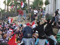 Egyptian Revolution, the army and demonstrators Royalty Free Stock Photos