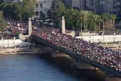 Egyptian Revolution - January 25 2012. Aerial shot of Kasr El Nil bridge leading to Tahrir (liberation) square. Bridge is covered by protestors heading towards Royalty Free Stock Photo