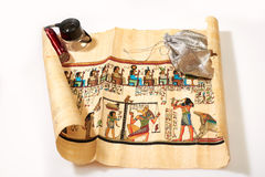 Egyptian roll and a bag of money. On white background royalty free stock images