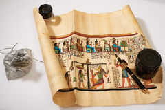 Egyptian scroll, pen and a bag of money Royalty Free Stock Photography