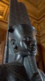 An Egyptian sculpture on display in Louvre, Paris, France Royalty Free Stock Photos