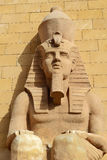 Egyptian sculpture of a sitting man Stock Photography
