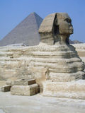 Egyptian Sphinx. The Sphinx and a Pyramid at Giza, Egypt Stock Photo