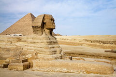 Egyptian Sphinx with pyramid in Giza Stock Image