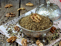Egyptian spice blend Dukkah nuts, black pepper, coriander, fennel, cumin and other spices. Selective focus royalty free stock photos