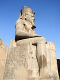 Egyptian statue. With hieroglyph and a blue sky Stock Photography