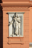 Egyptian statue on the museum in Cairo. Exterior detail with woman pharaoh on the Egyptian museum in Cairo stock image