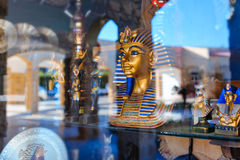 Egyptian statue in the storefront behind the glass Stock Photos