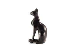 Egyptian statuette of a black cat. On a white background Royalty Free Stock Photography
