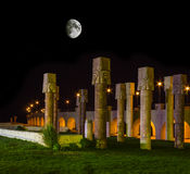 Egyptian stone columns at night under the moon Stock Photos