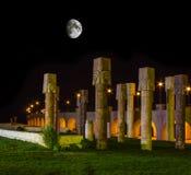 Egyptian stone columns at night under the moon Stock Photos