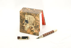 Egyptian style notebook and pen Stock Images