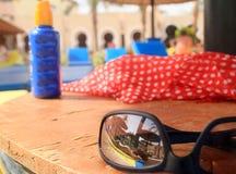 Egyptian sunbath. Reflection of woman tanning in SHarm el Sheikh Royalty Free Stock Photo