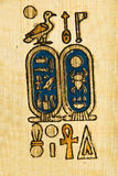 Egyptian symbols on papyrus. Ancient Egyptian symbols on papyrus painting on blue and golden color Royalty Free Stock Photo