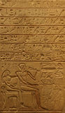 Egyptian Tablet. An ancient Egyptian tablet displaying various food items hieroglyphs, a man and a god royalty free stock photos