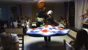 Egyptian Tanoura Dancer entertains tourists in the Baracuda restaurant in Hurghada stock video footage