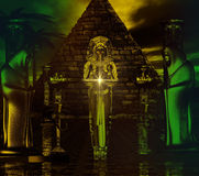 Egyptian Temple. Haunting digital art fantasy scene of Egyptian pyramid with priestess and hooded figures by her side. Royalty Free Stock Images