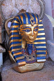 Egyptian tutankhamun mask. Photo of an egyptian mask similar to tutankhamun embellished with gold and blue gilt colouring. photo taken 9th sept 2015 royalty free stock photos