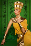 Egyptian woman in costume of the Pharaoh Stock Photos