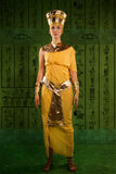 Egyptian woman in costume of the Pharaoh. Portrait of beautiful egyptian woman stylized into Cleopatra Royalty Free Stock Photography