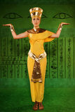 Egyptian woman in costume of the Pharaoh. Portrait of beautiful egyptian woman stylized into Cleopatra Royalty Free Stock Photo