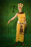 Egyptian woman in costume of the Pharaoh. Portrait of beautiful egyptian woman stylized into Cleopatra Royalty Free Stock Images