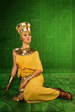 Egyptian woman in costume of the Pharaoh. Portrait of beautiful egyptian woman stylized into Cleopatra Royalty Free Stock Image