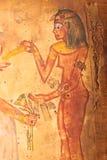 Egyptian woman painting on papyrus Stock Photos