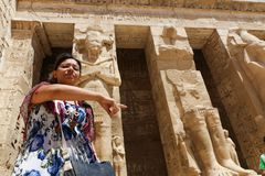 Egyptian woman at temple of Habu Royalty Free Stock Image