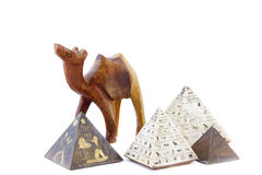 Egyptian wooden minature camel and pyramids Royalty Free Stock Images